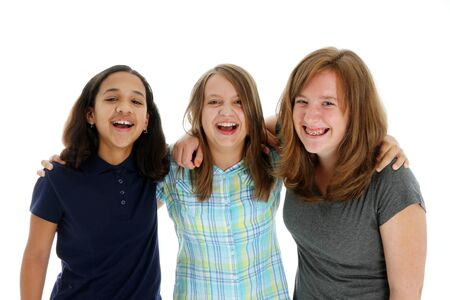 Teenage children in colorful shirts against a white background Stock Photo - 13399175