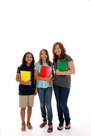 Group of Teenage Girls Ready for School on White Background Stock Photo - 13409214