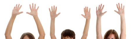 Group of teenage kids with their hands raised
