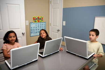 com: Children on computers at school  Stock Photo