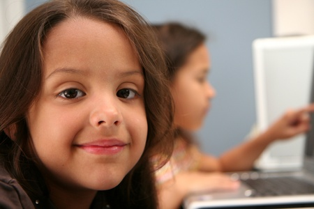 Children on computers at school photo