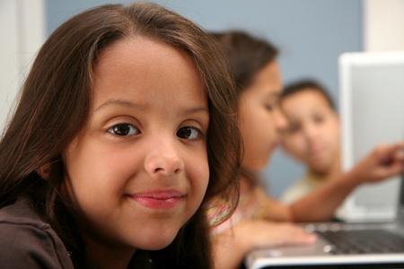 hispanic students: Children on computers at school  Stock Photo