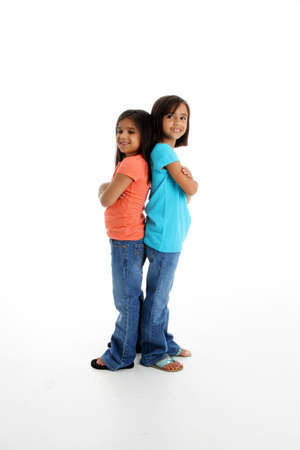 Young Sisters Standing Together on White Background Stock Photo - 13411351