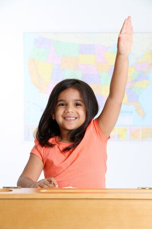 Happy Young Girl Raising Hand in School Stock Photo - 13399446