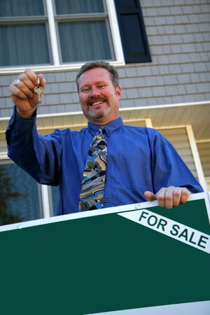 A real estate agent ready to sell a house photo