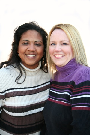 Two mixed race friends set on a white background photo
