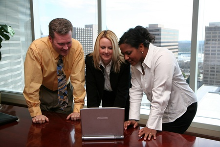 Business Team working in a downtown business office photo