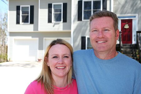A Happy Caucasian Couple Outside Of Their Home Stock Photo - 13408563