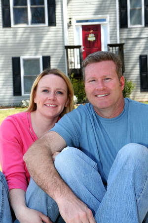 A Happy Caucasian Couple Outside Of Their Home Stock Photo - 13399812