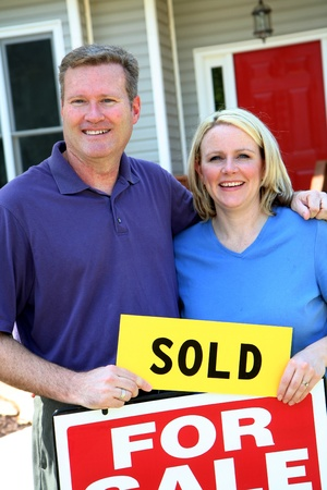 sales agent: Couple selling their home Stock Photo