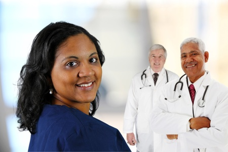 Group of doctors and nurses set on white background
