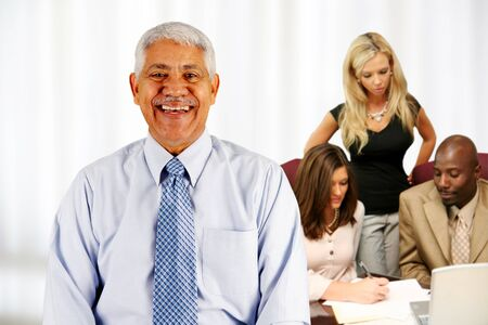 Business team working on a project in their office Stock Photo - 13398734