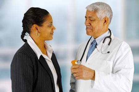 Man giving a prescription to his customer Stok Fotoğraf