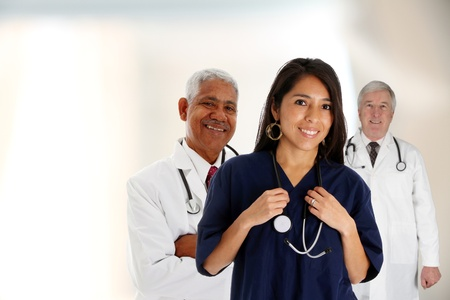 mature mexican: Doctors and nurse standing in a hospital