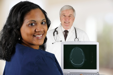 Doctor and Nurse working in a hospital photo