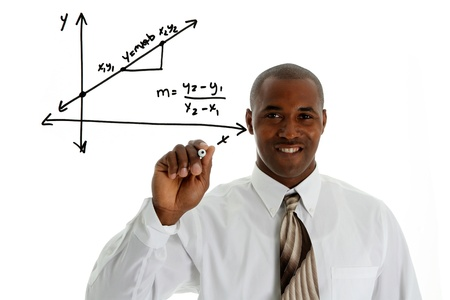 Math Teacher doing a math problem with black marker Stock Photo - 13459682