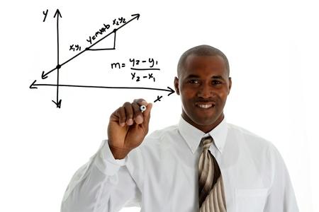 Math Teacher doing a math problem with black marker Stock Photo - 13459682