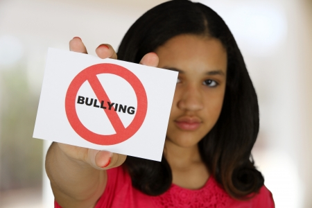 anti social: Teen girl holding a card that says no bullying