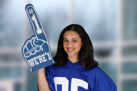color fan: Teenage girl set against a white background in jersey Stock Photo