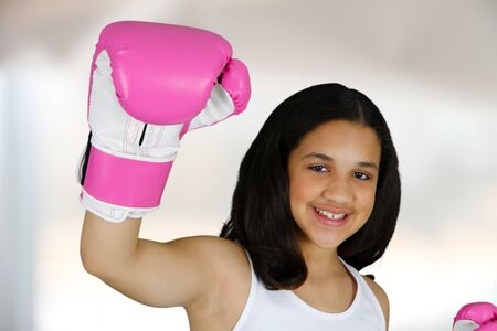 Teen girl with pink boxing gloves on photo