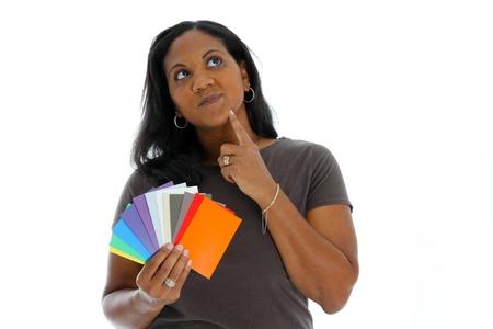 使用する塗料のチップを見ている女性 写真素材