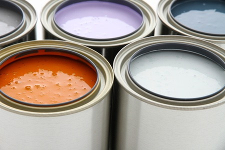 Paint cans ready to be used on white background photo