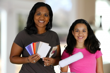 Woman looking at paint chips to use with daughter photo