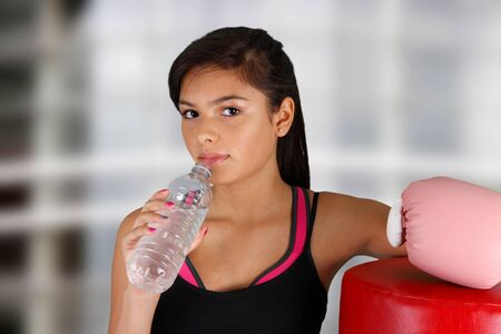 Teen girl working out in the gym Stock Photo - 14083334