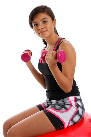 Teen girl working out in the gym photo