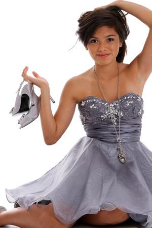 pretty dress: Teenage girl set against a white background