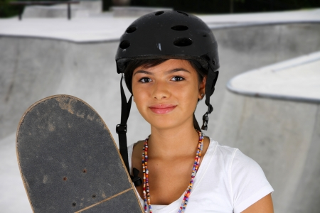 Girl skateboarding outside on a nice day photo