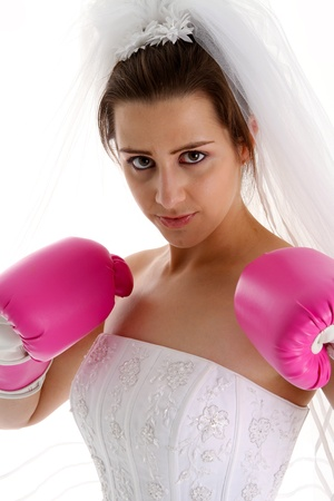 Woman in a wedding dress with boxing gloves photo