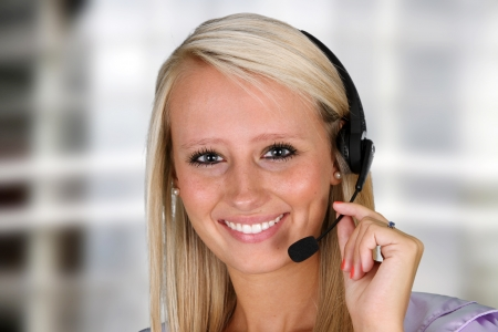 sales call: Young woman giving help as a customer service employee