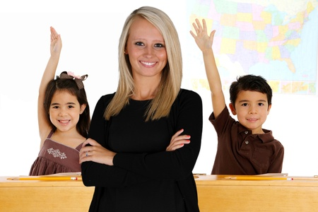 employment elementary school: Teacher with her students in a classroom Stock Photo