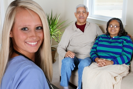 Home health care worker and an elderly couple Stock Photo - 14251036