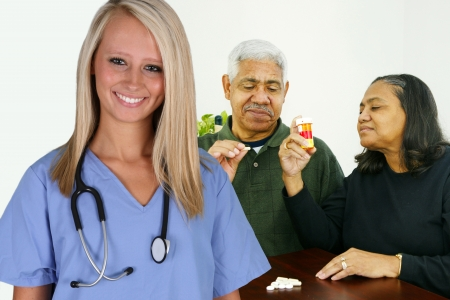 Home health care worker and an elderly couple photo