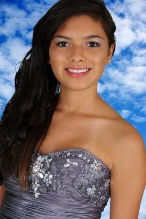 Teenage girl in her prom dress outside photo