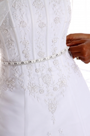 Woman in a wedding dress on white background photo