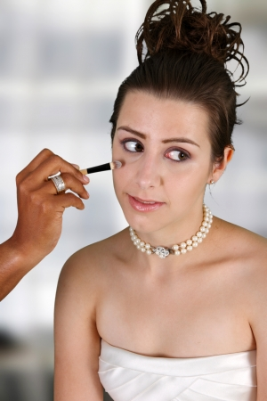 Woman in a wedding dress getting ready photo
