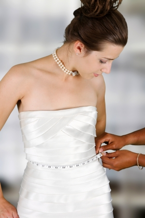 tailor measure: Woman in a wedding dress getting ready for the day Stock Photo