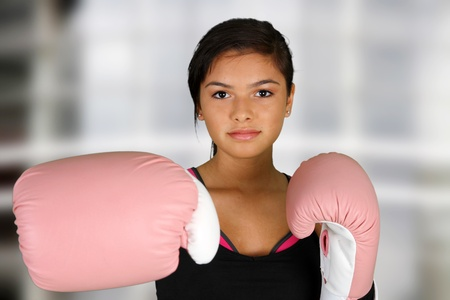 girl kick: Teen girl working out in the gym Stock Photo