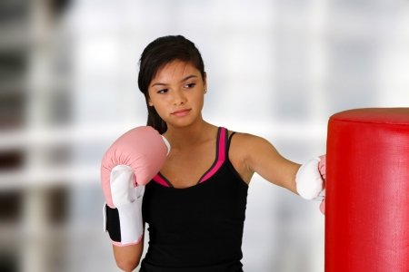 Teen girl working out in the gym Stock Photo - 14383697