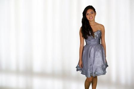 Teenage girl set against a white background photo