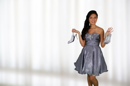 girl in dress: Teenage girl set against a white background