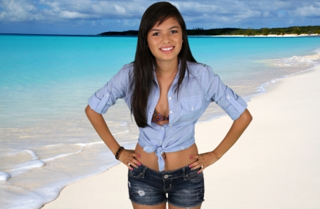 Teen girl at a crystal clear beach