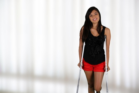 Girl standing on crutches in the hospital photo