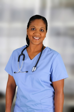 Minority nurse working at her job in a hospital photo
