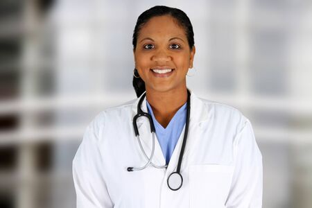 Minority doctor working at her job in a hospital photo