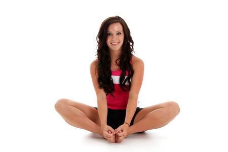 Teen girl working out on a white background