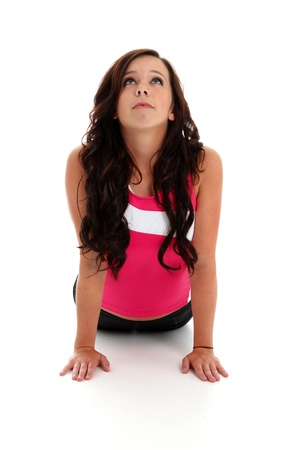 Teen girl working out on a white background photo